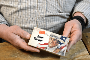 Skip Steinbrecher holds a box of John Wayne brand .32-40 Winchester ammunition. At $69 a box, it's more a conversation piece than anything. Steinbrecher stocks many less-common types of ammunition that can be challenging to find.