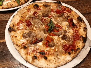 The Don't Forget Sausage pizza with caramelized onions, roasted red peppers, and flavorful sausage.