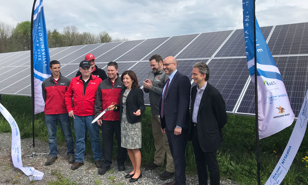 Lt. Gov. Kathy Hochul( center) joined local officials during the ribbon cutting for the new solar panels at Anheuser Busch in Baldwinsville.