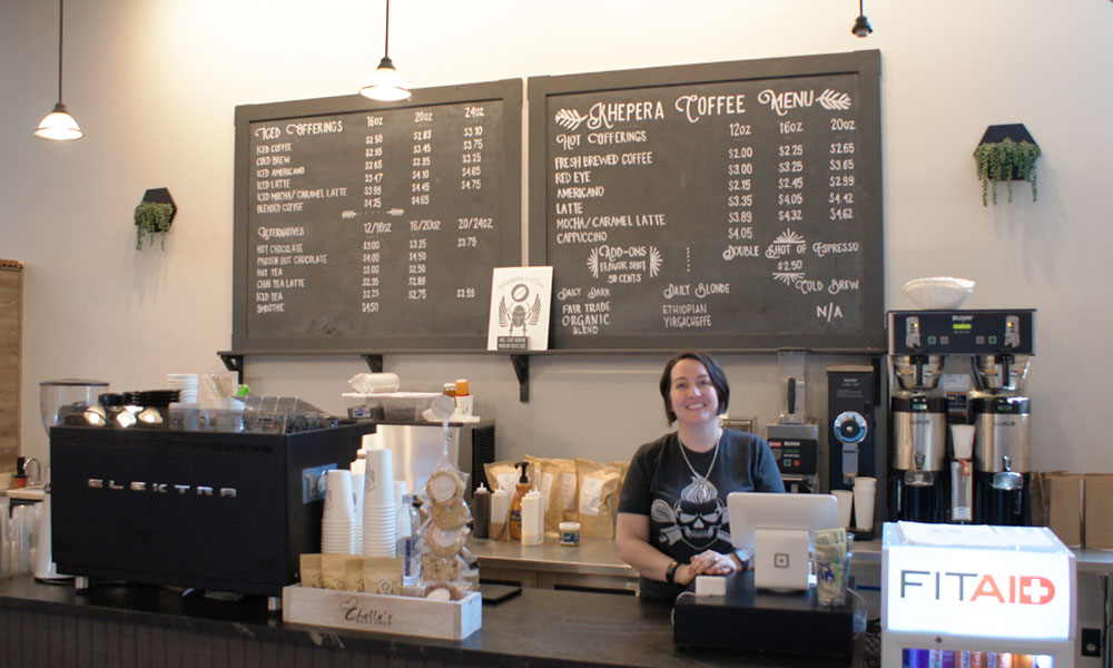 Jessica Spano at her new Khepera Coffee, which opened July 17 in the Canal Commons, Oswego.