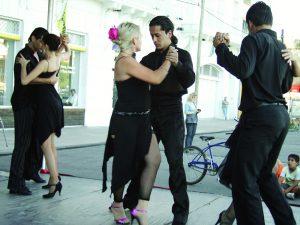 Tango dancers prance along the sidewalk in between photo ops in La Boca, a Buenos Aires neighborhood.