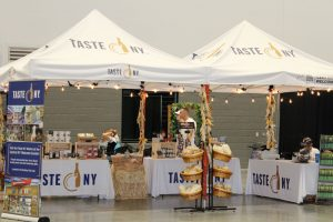 Nelson Farms operated the Taste New York booth at the New York State Fair this past summer. The farm operates a food processing incubator that enables other businesses to develop their own private label goods to sell as their own. Photo by Deborah Jeanne Sergeant