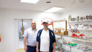 Real estate broker Bill Galloway and Ron Regan (left). They formed a partnership, along with Jeff McCrobie, a former Oswego fire chief; and Diego Lebaudy, a local lawyer, to reopen Stone's Homemade Candy Shop. Reagan was the owner.