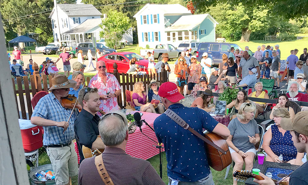 'Fair Haven is a village that likes to live, love and laugh. Visit a couple times, and you're no longer a stranger.' Pictured is last summer's Porchfest, one of the new events held at the village.