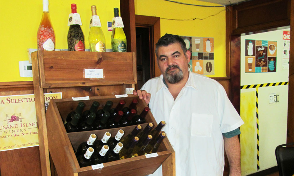 "Lenny Costa next to a wine rack in his Casa Brazil Restaurant & Hotel in Pulaski. ""The majority of people who visit us are now regular returning customers who appreciate freshly made-to-order flavorful food,"" he says"