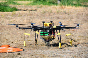 A Dropcopter custom-built drone sits grounded, awaiting another pollination run.