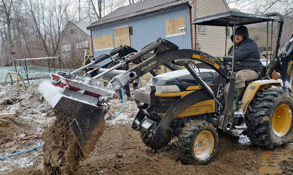 William Barry has invested over $20,000 into equipment for his landscaping business, including excavation machinery that will allow him to install underground water lines. He was the first person to file a doing business as (DBA) in Oswego County.