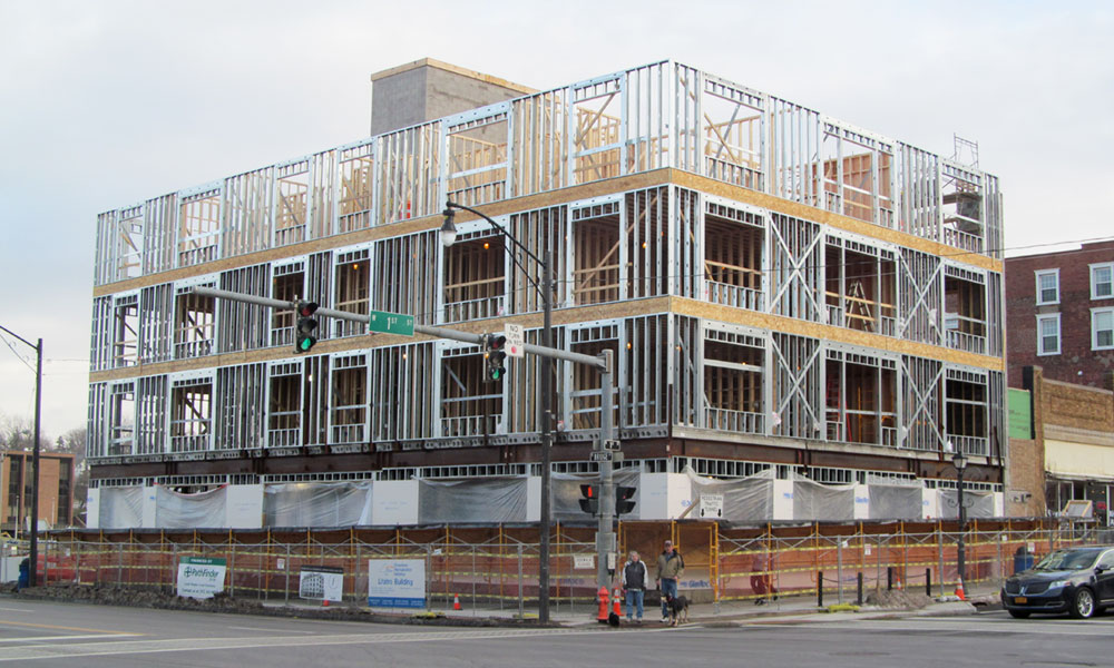 "Construction of the LITATRO (acronym for ""Luck is the Ability to recognize opportunity"") building, seen as the future cornerstone of downtown Oswego, is well under way and ahead of schedule. It will be a five-story, mixed-use hub for businesses and 21 upscale apartments. Restaurants on the first floor and a rooftop deck are expected, as is underground parking."