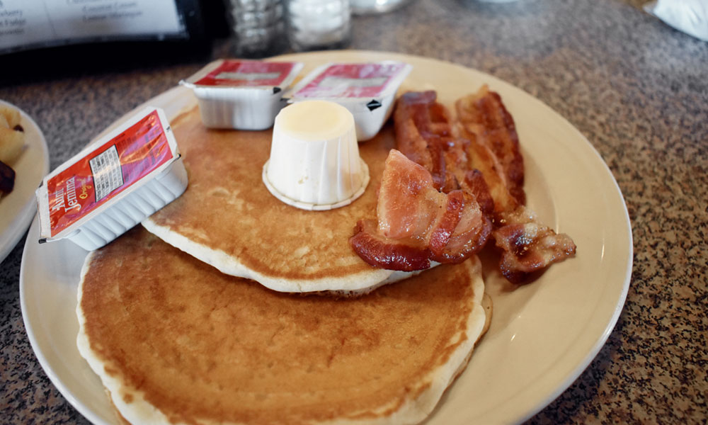 The light, golden-colored pancakes had a light crisp around the edge. The bacon was not too crispy, not too flimsy, but just right.