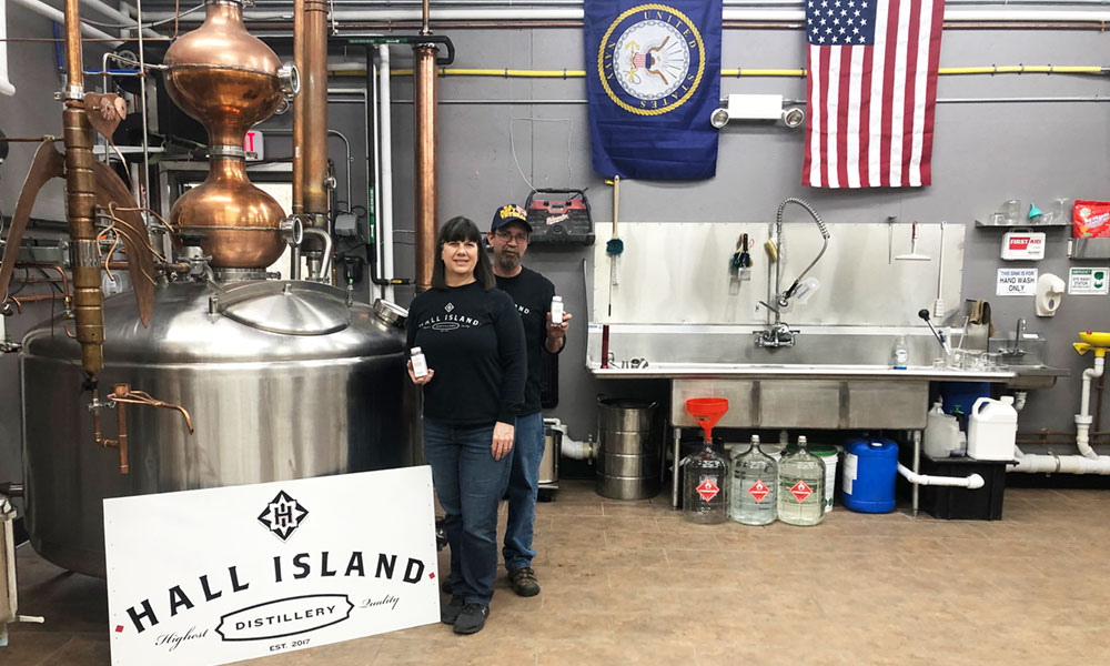 Ann and her husband Dave Benton, the owners of Hall Island Distillery in Cicero, shifted from making vodka to making hand sanitizer.
