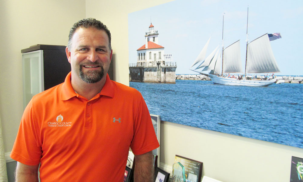 CEO Bill Carhart at his office at 90 E. Bridge St. in Oswego.
