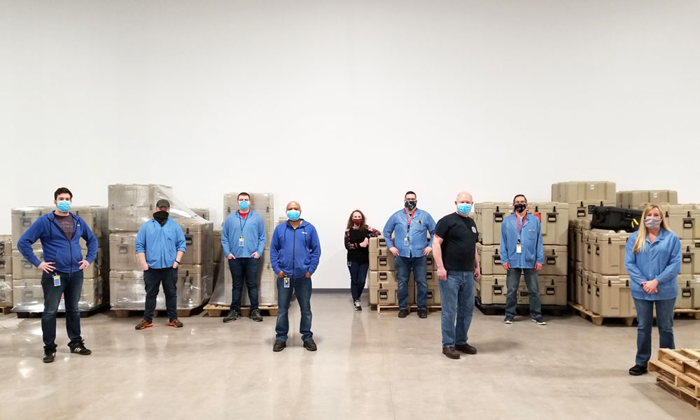 SRCTec employees in its manufacturing facility in North Syracuse demonstrate the use of facemasks as well as social distancing due to the COVID-19 threat.