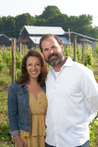 Ana Maria and husband Joe Murabito at their new Baldwinsville vineyard, Strigo Farmhouse, July 2. Photo by Chuck Wainwright.