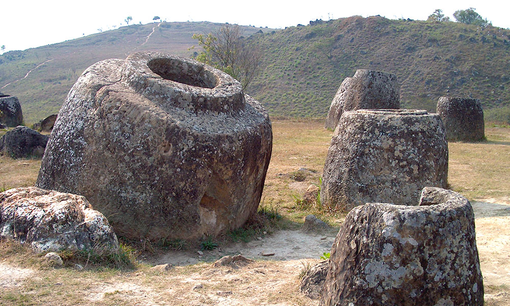 Plain of Jars: Thousands of jars scattered across the plain some weighing 14 tons. Their origin is still open to speculations.