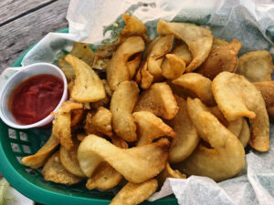 The local favorite Sandy Pond skippers: The thick cut, lightly salted fries are lightly covered in garlic butter, parmesan cheese and parsley. These are some of the best fries I've enjoyed.