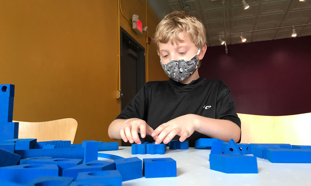 Arius Cunningham, 7, plays foam building blocks at the Children's Museum of Oswego.