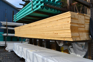 Lumber and other building materials sit stacked at New Haven Building Supply. Store owners have struggled to keep certain items, such as pressure-treated lumber, in stock.