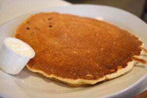 The pancakes ($3.59 or $1.20 for one). The semi-flat flapjack is soft and slightly