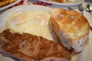 The western breakfast ($7.99) at Mimi's. My eggs came over easy, as requested. The toast was thick-sliced Italian bread, toasted to golden brown perfection. The sirloin — meh.