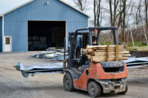 A forklift moves metal roofing at New Haven Building Supply.
