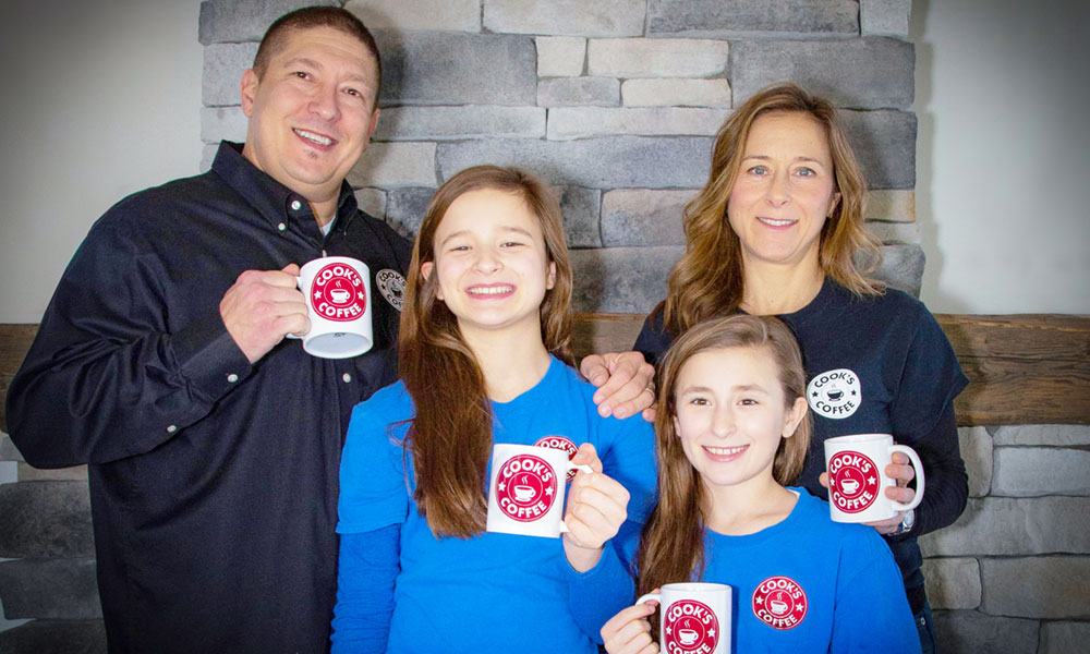 Brian Rossi and his family of Fabius, promoting the coffee he sells in the region.