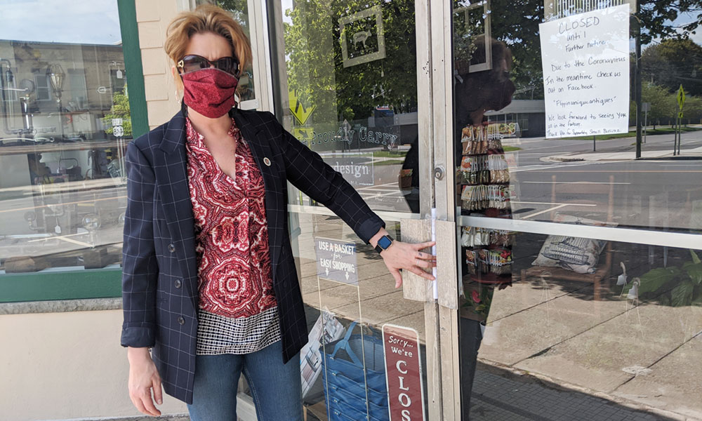 City of Fulton Mayor Deana Michaels is shown visiting a downtown business last spring to distribute a COVID-19 safety packet.