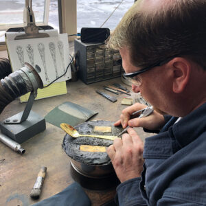 Eric Lawrence tools and designs a piece of flatware.