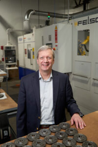 """Randy Wolken, MACNY's president, at Gear Motions, a leading gear manufacturer in Syracuse: """"Manufacturing has changed primarily in the way in which we make things. The reality is it's just much more automated and it's also using a lot of high-tech skills."""""""