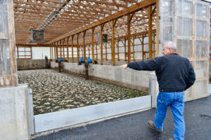Mexico Public Works Superintendent John Powers points out new waste drying beds at the village's waste treatment plant. The facility was constructed in 1978, but went decades without significant upgrade before being renovated into a state-of-the-art treatment plant.