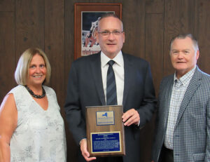 Ellen Holst, OOC board president, Peter Wiltsie, Wiltsie Construction Company president, and L. Michael Treadwell, OOC executive director.