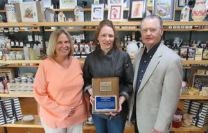 Ellen Holst, OOC board president, Rebekah Alford, owner and chef at Rainbow Shores and Mill House Market Deli & Bakery, and L. Michael Treadwell, OOC executive director.
