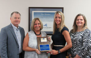 L. Michael Treadwell, Ellen Holst, Tricia Peter-Clark, ConnextCare president and CEO, and Stephanie Earle, ConnextCare director of human resources.
