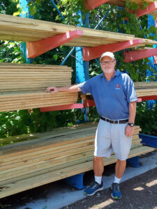"""Chuck Handley, owner of Burke's Home Center, attributes the lower prices to the time of year. """"Now is the time to buy, before people start buying lumber to prepare their homes for winter,"""" he says."""