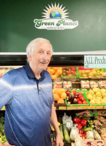 Brent Lewis is the owner of Green Planet Grocery. He started the business in Oswego in 2004; in 2010 he opened a second location in the Fairmount are of Syracuse. He is shown at the Fairmont location.