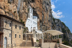 Ostrog Monastery, Montenegro's most holy site carved into a vertical mountainside, offering a panoramic view of the countryside.