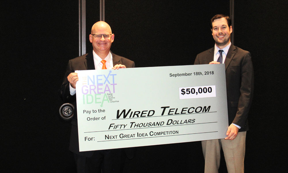 Pictured are, Ed Alberts (left), owner of Wired Telcom and winner of 2018 Next Great Idea Oswego County Business Plan Competition, and Austin Wheelock (right), NGI Chairperson.