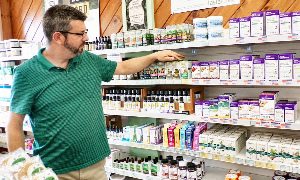 Eric Mena, the general manger of Green Planet Grocery in Oswego.